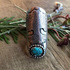 Unique artisan designed turquoise saddle ring